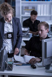 Police woman reviewing files Stock Photos