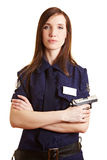 Police woman with service weapon. Young police woman with her service weapon Royalty Free Stock Image