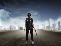 Police woman standing on the empty street Royalty Free Stock Photo