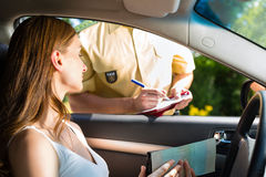 Police - woman in traffic violation getting ticket Stock Images