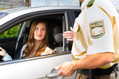 Police - woman in traffic violation getting ticket. Police - young woman with policeman or cop on the street or traffic Stock Photos