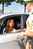 Police - woman in traffic violation getting ticket. Police - young woman with policeman or cop on the street or traffic Royalty Free Stock Photo