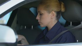 Police woman wearing seat belt and sunglasses, patrolling district, road safety. Stock footage stock video