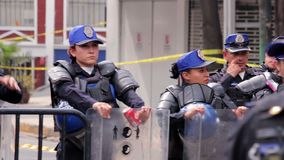 Police women guard the disaster zone, affected by the earthquake. La Roma, Mexico City, 21/09/17. Police women guard the disaster zone, affected by the stock video footage