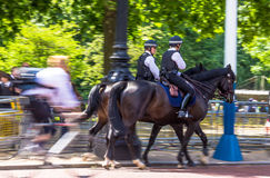 Police women on horseback on  The Mall, street in front of Buckingham Palace in London. UK Stock Image
