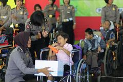 Police Women Play with Children with Disabilities. 29/08/2016, Yogyakarta, Indonesia: Police Women play with children with disabilities in a social home in Royalty Free Stock Photography