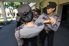 Police women. Police woman practicing martial arts at the police station yard in the city of Solo, Central Java, Indonesia Royalty Free Stock Photo