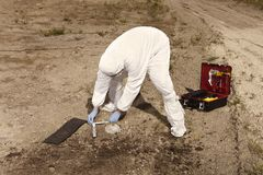 Police at work - human skull documenting on plain construction yard during work royalty free stock photography