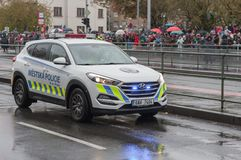 Police worker riding car on military parade