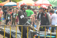 Police working in water festival or Songkran festival Royalty Free Stock Images