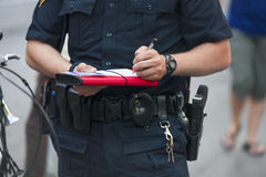 Police writes ticket. A police man writes ticket in the city Stock Image