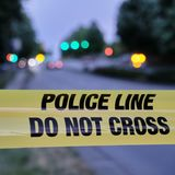 Police yellow line, blurred lights and traffic accident in background.  stock images