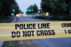 Police yellow line, blurred lights and traffic accident in background.  royalty free stock photo
