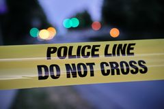 Police yellow line, blurred lights and traffic accident in background.  stock photo