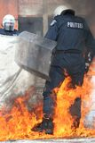 Police2. Policeman in a burning flame Stock Photos