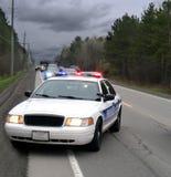 Policecar Seite der Straße Stockbilder