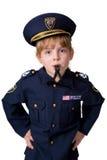 Policegirl che salta il suo fischio Immagine Stock