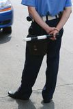 Policeman. A policeman in uniform near the car Stock Photo