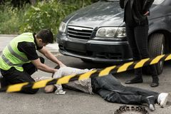 Policeman on the accident scene Stock Photos