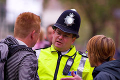 Policeman is advising the people Stock Photo