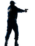 Policeman aiming handgun Royalty Free Stock Photography
