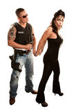 Policeman arresting pretty woman Stock Photography