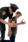 Policeman arresting teen criminal Royalty Free Stock Photography