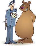 Policeman and bear. Policeman checking bear's ID Royalty Free Stock Images