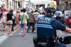 Policeman in bike during the demonstration for peace Royalty Free Stock Photography