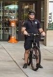 Policeman on Bike Patrol Stock Image