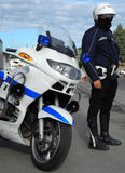 Policeman biker. Controlling traffic beside his bike Stock Images