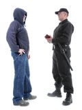 ID checking. Policeman in black uniform checking ID of hooded suspect, shot on white Stock Photos