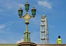 Policeman bobby, victorian lamp and London eye. London icons of policeman bobby, Victorian westminster lamp and London eye from the unusual angle of a boat in Royalty Free Stock Photo