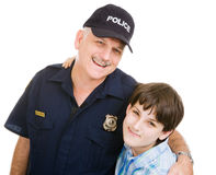 Policeman and Boy. Friendly police officer and an adolescent boy.  Isolated on white Royalty Free Stock Images