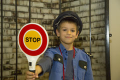 Policeman boy Stock Images