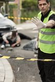 Policeman at car accident area Stock Photos