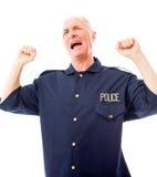 Policeman celebrating success Royalty Free Stock Photos