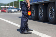 Policeman controlling traffic on the highway Royalty Free Stock Images