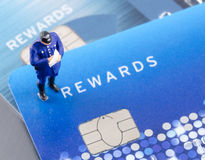 Policeman on the credit card, online shoping security Royalty Free Stock Photos