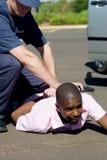 Policeman and criminal. Policeman arrest a dangerous criminal at gun point stock photos