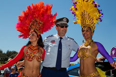 Policeman and dancers Royalty Free Stock Photo