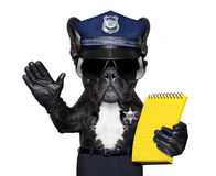 Policeman dog with  ticket fine. POLICE DOG ON DUTY WITH ticket fine and hand , isolated on white blank background, behind black banner or placard Royalty Free Stock Photo