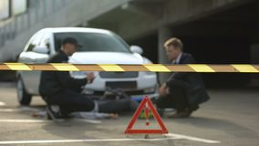 Policeman with driver writing report after accident with bicycle, crime scene. Stock footage stock video