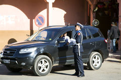 A policeman explains to a road the traveller Royalty Free Stock Image