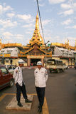 Policeman in front of the Sule Paya Pagoda in Yangon Stock Photos