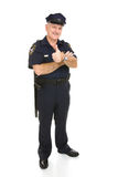 Policeman Full Body Thumbsup. Policeman giving the thumbs up sign.  Full body isolated on white Royalty Free Stock Images