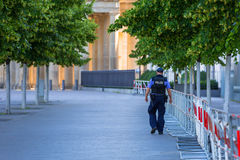 Policeman on guard in the city center of Berlin, Germany Stock Images