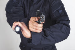 Policeman gun Royalty Free Stock Images