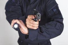 Policeman gun. Policeman with gun and flashlight Royalty Free Stock Images
