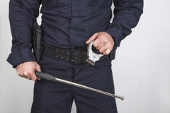 Policeman gun Stock Photo